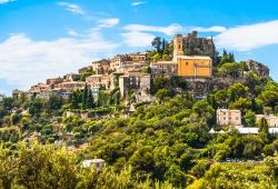 Panoramic view of the hilltop village of Eze under a beautiful blue sky