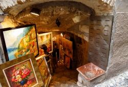 Paintings on display in front of an art gallery in the hilltop village of Saint-Paul-de-Vence