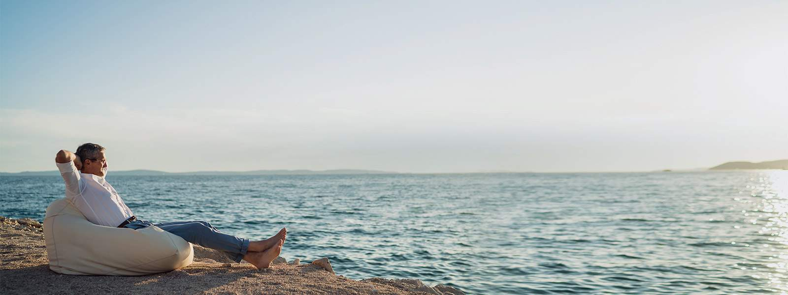 A yacht owner enjoying a relaxing moment with a panoramic view of the sea
